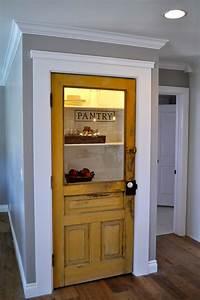 Vintage farmhouse door repurposed as pantry door - by