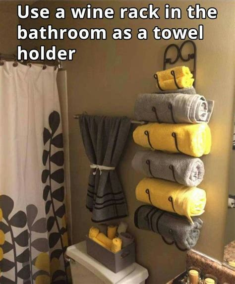 Bathroom Towel Decorating Ideas by Use A Wine Rack For A Bathroom Towel Holder Awesome