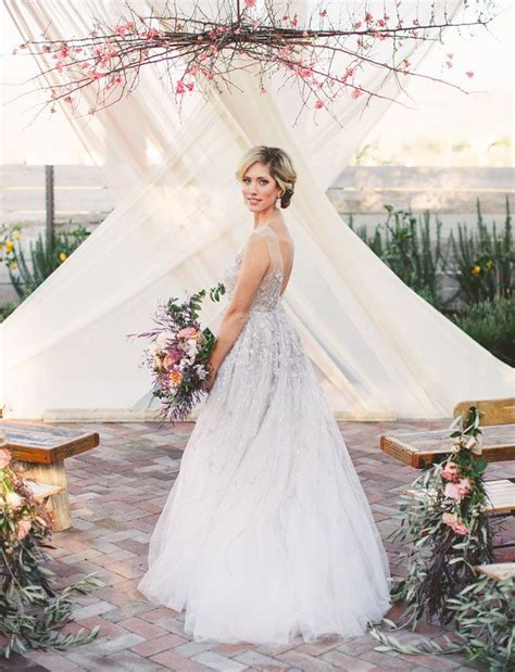 chic rustic wedding ideas  tree branches tulle