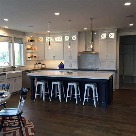 white kitchen  navy blue island kitchen  white
