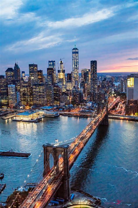 - Aerial view of Brooklyn bridge at dusk, New York, USA ...