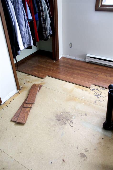 installing oak flooring installing laminate flooring and a new rug too bright green door