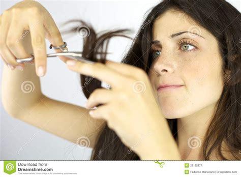 beautiful girl cutting long hair stock image image