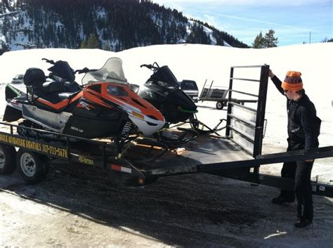 catching air with jackson snowmobile tours picture