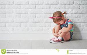 Little Child Girl Crying And Sad About Brick Wall Stock ...