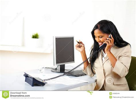 i was on the phone entrepreneur talking on phone at work royalty free stock