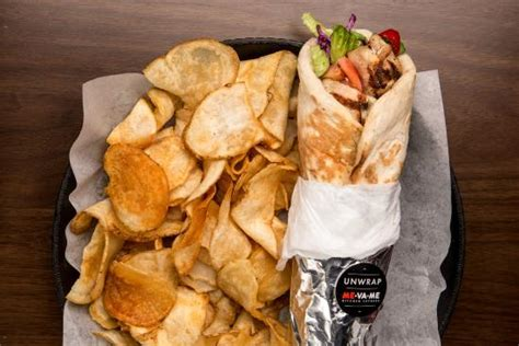 Va Me Kitchen Express Ontario shawarma on our hummus picture of me va me