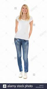 Attractive young woman standing in front of plain white ...