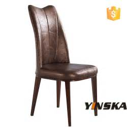 brown antique high back leather dining chair and dining