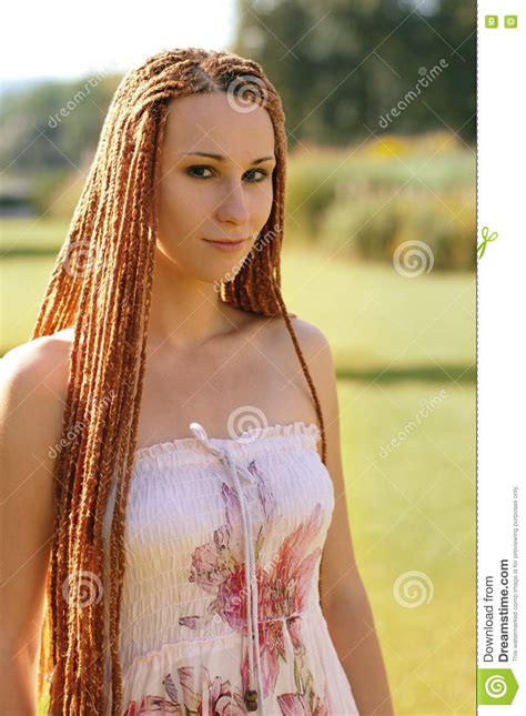 Girl with red pigtails stock photo. Image of grass, nature ...