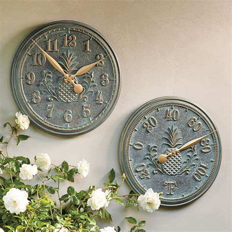 classic pineapple outdoor clock and thermometer