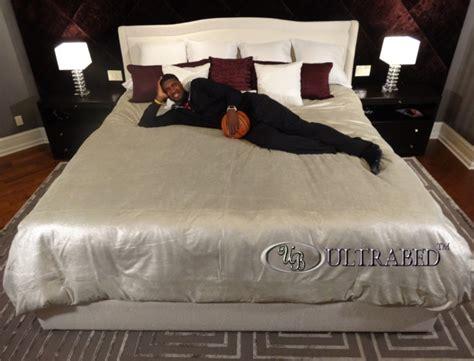 Allstar Basketball Center Scores Big After Good Night's Rest. Brick Backsplash. Pantry Cabinets. Fancy Bed. Key Hook Rack. Vaulted Ceiling Lighting. Outdoor Door Mats. Garage Loft. Tall Medicine Cabinet