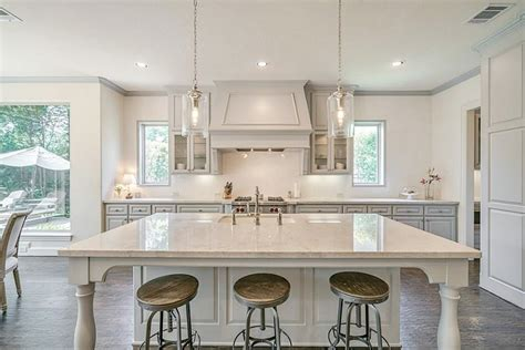 mindful grey cabinets what gray paint color is best here are my favorites 282   After kitchen remodel with Sherwin Williams Mindful Gray cabinets and Taj Mahal quartzite counters