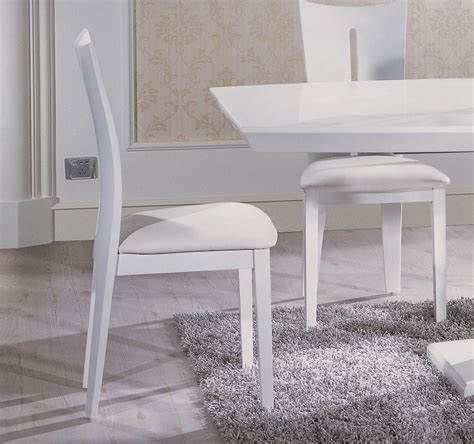 white leather contemporary dining chair with stylish split