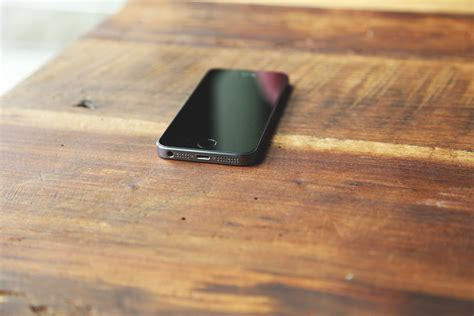 Free Images : iphone, smartphone, screen, table, wood
