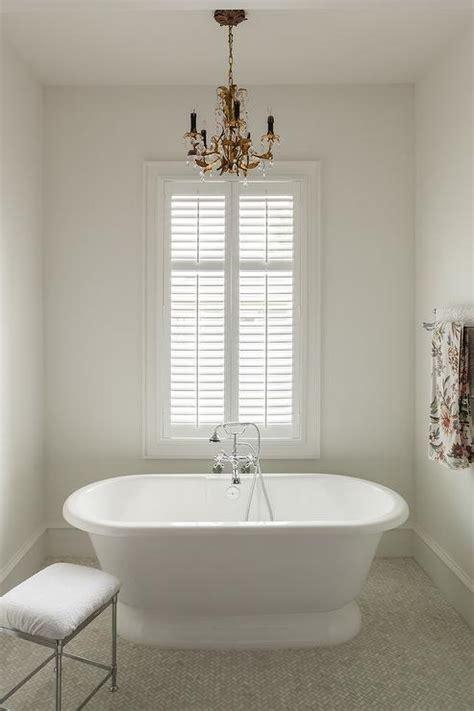 marble clad bathtub  paris flea market chandelier