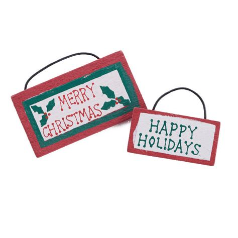miniature happy holidays and merry christmas signs