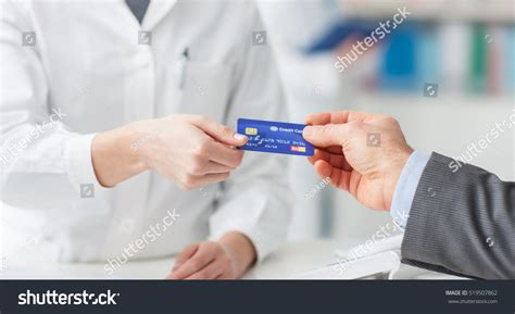 Man Pharmacy Making Purchases Credit Card Stock Photo