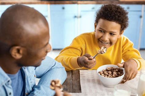 smiling boy  breakfast   father stock photo