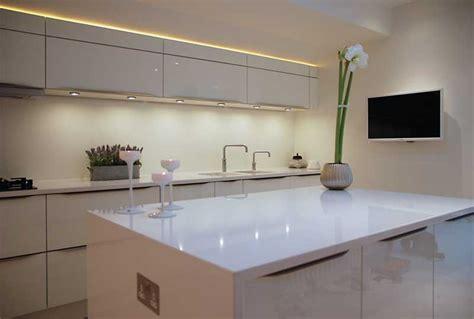 lights for island kitchen high gloss white kitchen with white quartz worktops