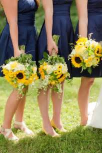 floral bridesmaids robes navy bridesmaids dresses sunflower bouquets katelyn photography weddings