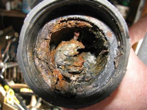 clogged kitchen sink drain pipe clear a clogged kitchen sink with these easy to follow 8232