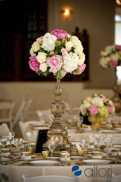 white pink green yellow wedding table arrangement floral