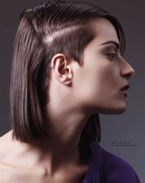 Bob haircut with a short cropped side and mini sideburns