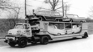1957 Fords  New Being Delivered To A Dealer By A 1956 Ford