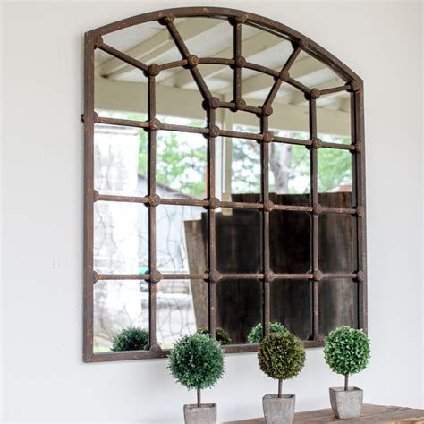 arched iron mirror w rosettes