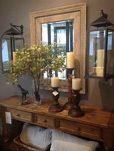 I love the hanging lanterns flanking the mirror. Rustic ...