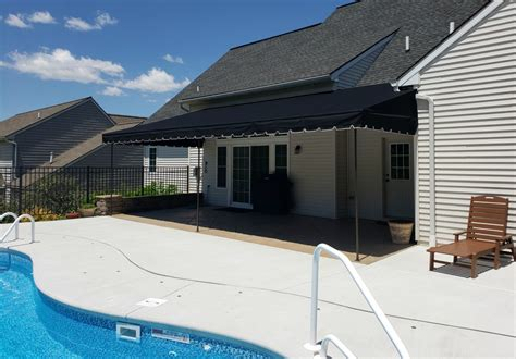 black sunbrella canopy   pool kreiders canvas service