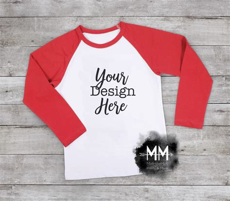 You can easily change your design with smart object. Red Raglan Mockup Shirt Mockup T-Shirt Mockup Styled Shirt ...