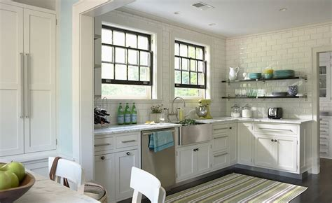 stainless steel apron sink white cabinets ceiling height backsplash transitional kitchen this