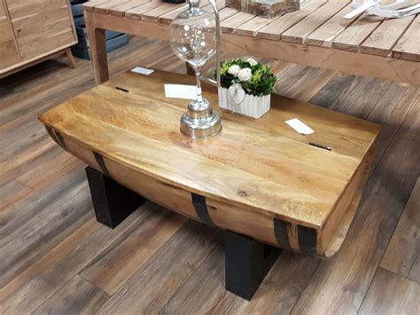 Attach the whiskey barrel to the base using 3 inch wood screws. Rustic Half Barrel Coffee Table