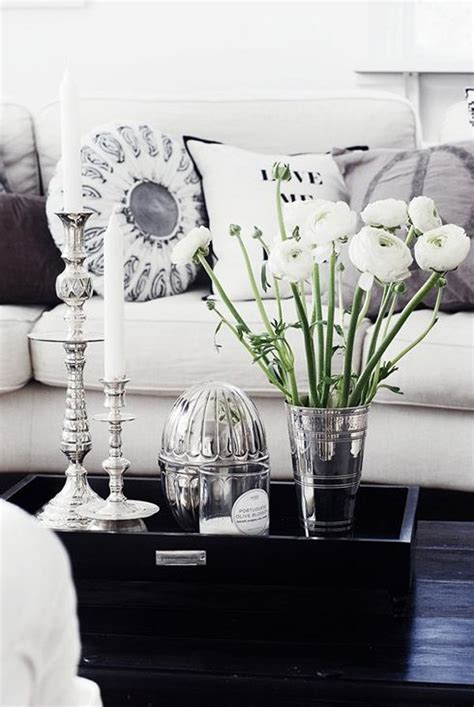 The tablecloth that you choose should go well with the surroundings, like the sofa color, cushion, cupboard, or other things in your living rooms. 29 Tips for a perfect coffee table styling - BelivinDesign
