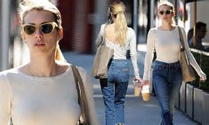 Emma Roberts cuts a stylish figure in skintight top and ...