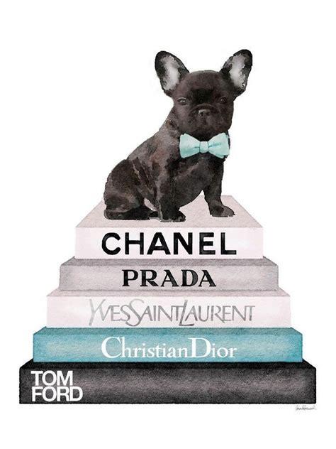 french bulldog sits atop  stack  designer books