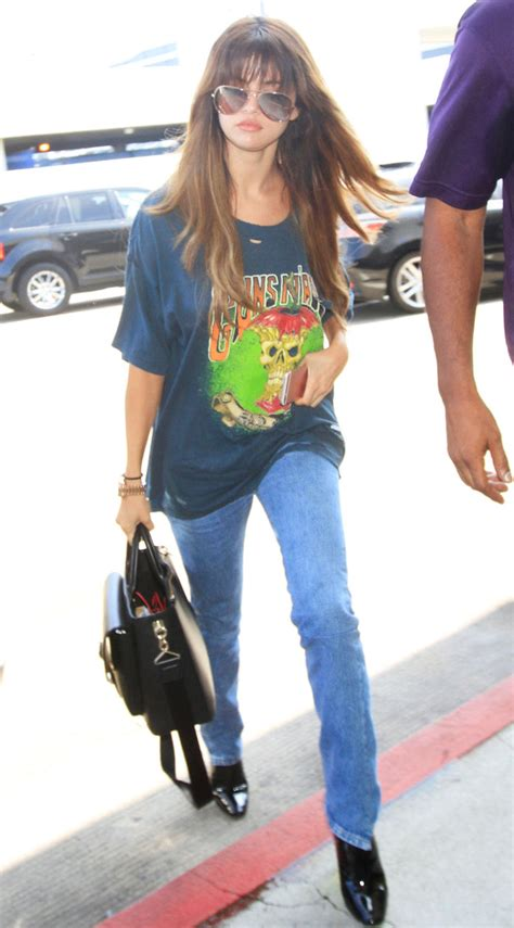 selena gomez wears guns  roses  shirt  lax airport