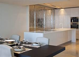 White kitchen island silver feature wall interior design