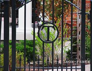 closer shot of a custom iron gate with a letter cut and With wrought iron gate letters