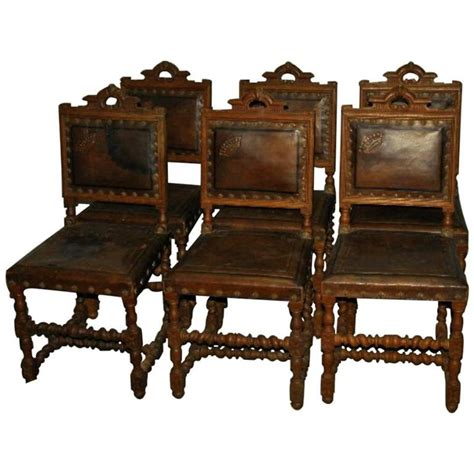 set of six antique colonial carved oak and leather