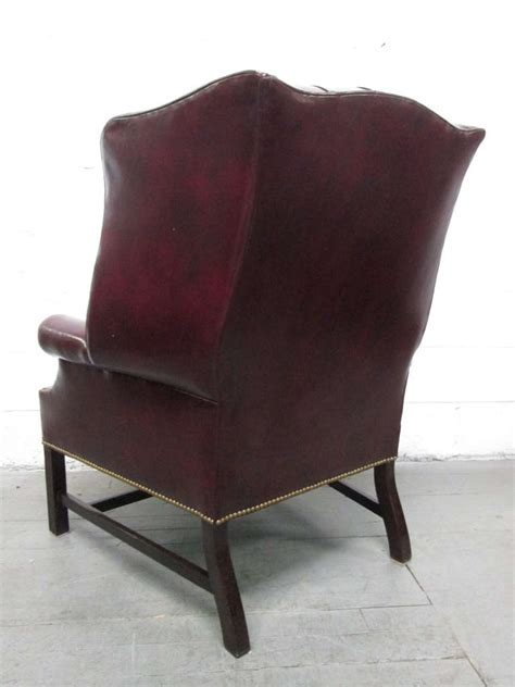 pair of vintage leather tufted wingback chairs for sale at