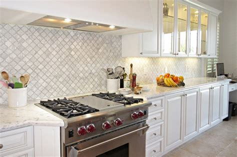 transitional kitchen backsplash ideas marble arabesque backsplash stainless range transitional 6345