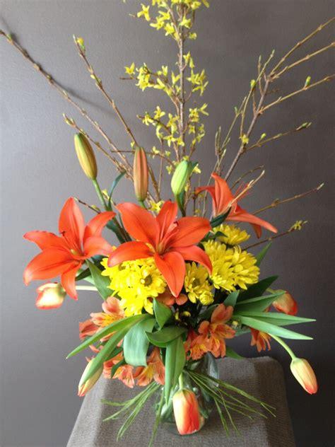 forsythia flower arrangements lily forsythia and tulip fresh arrangements showcase design n bloom