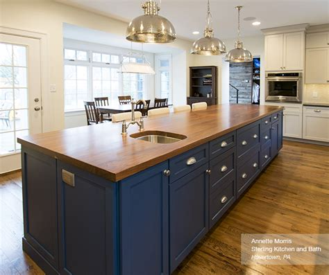 blue and white kitchen cabinets off white cabinets with a blue kitchen island omega