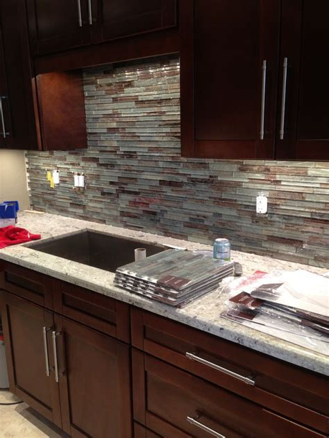 Glass tile backsplash for condo kitchen.   Condo