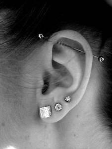 Double Lobe And Triple Cartilage Ear Piercing Ear