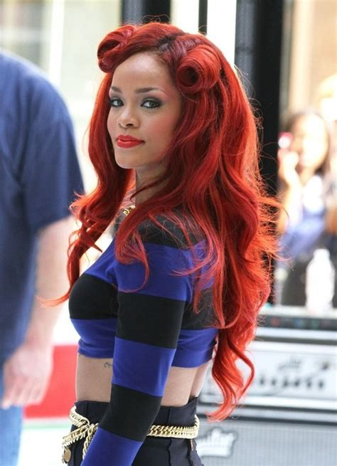 rihanna     long curly red hairstyle