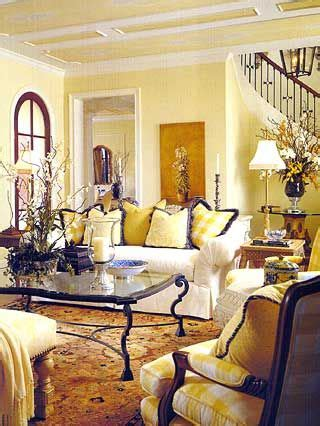 yellow walls living room interior decor yellow walls with deeper gold rug accents very dark woods classic warm welcoming living